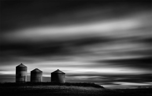 Dan Jurak, landscape, fine art, fineart, long exposure, black and white, landscape, prairie, Alberta, silos, Canada, dark, cloudy,