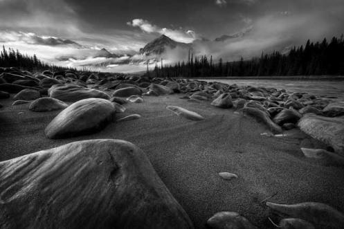 Athabasca River, mountains, boulders, rocks, monotone, black and white, low key, Dan Jurak, Jasper, rockies, Travel Alberta,